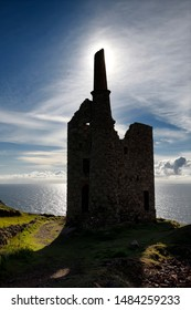 Silhouette of West Wheal Owles tin mine engine house ruins of Cargodna Mine in Botallack Cornwall England on the Atlantic Ocean Botallack, Cornwall, England - June 12, 2019