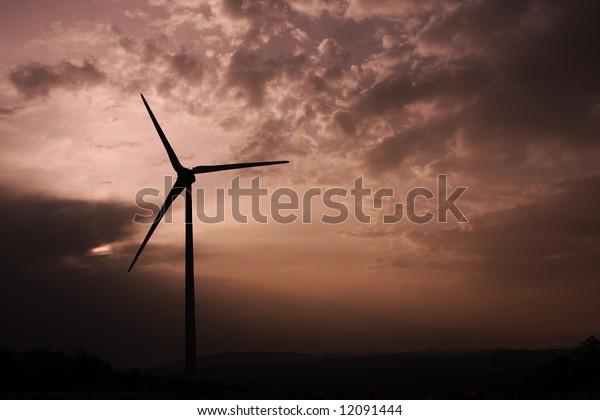 Silhouette of a wind energy converter; alternative energy generation.