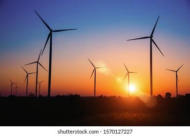 Silhouette of the wind turbine at sunrise in Huay Bong Wind Farm, Dan Khun Thot, Thailand. - Image