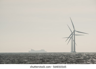 Silhouette wind turbines.