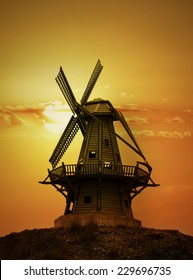 silhouette of windmills at sunset
