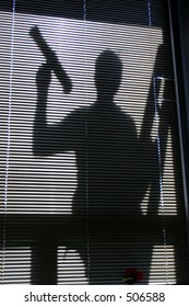 Silhouette of a window washer