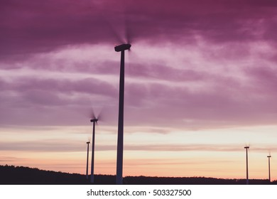 silhouette windturbines power station at beautiful sunset