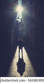 Silhouette of woman with big shadow on the street
