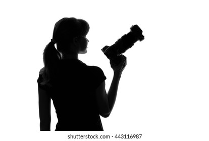 silhouette of a woman with a camera in hand