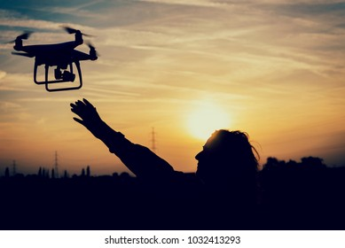 silhouette of an woman catching a drone