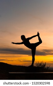 Silhouette woman coach yoga practice at sunset. Yoga concept. Lord of the Dance Pose. Natarajasana