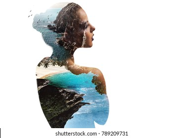 Silhouette of a woman combined with a rocky coast and sea. Double exposure.