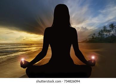Silhouette of woman doing yoga