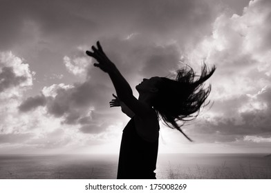Silhouette of woman enjoying nature. Freedom concept.