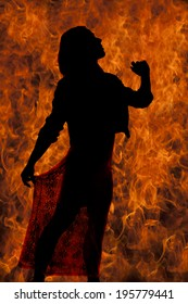 a silhouette of a woman with a fire background.