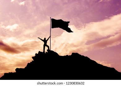 silhouette of a woman with a flag on top of a mountain at sunset.the concept of success in business.