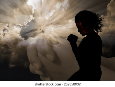 A silhouette of a woman to God