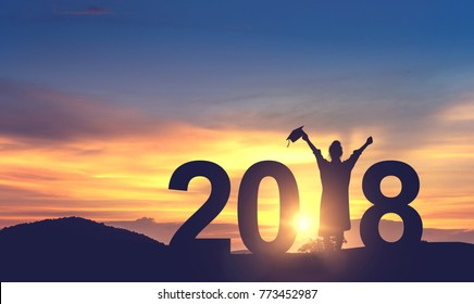 Silhouette Woman Graduation in 2018 years with Congratulation, copy space.