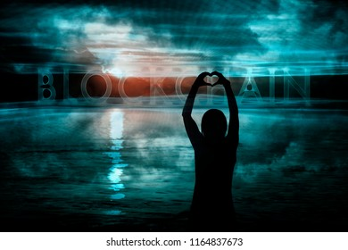 Silhouette of woman hands in heart shape with conceptual blockchain cyberspace background.
