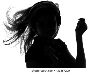 silhouette of a woman with headphones