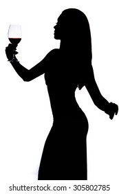 Silhouette of a woman holding the wineglass