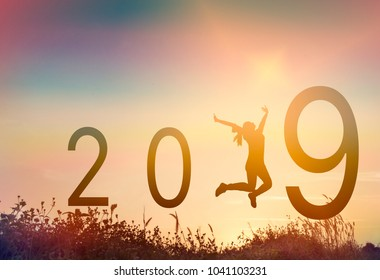 silhouette a woman jumping graduation in 2019 years with congratulationsame happy woman with new