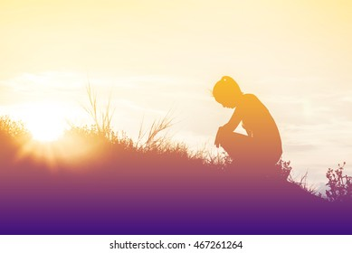 silhouette woman knee down with her hands