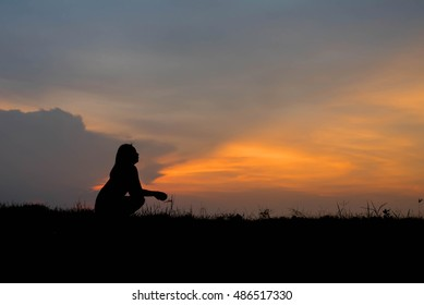 silhouette of woman Looking for a dream at sunset