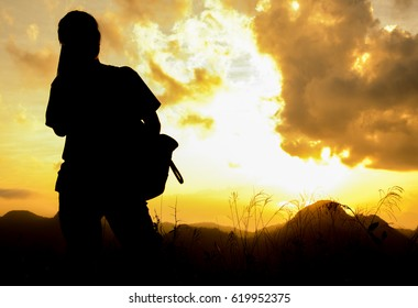 Silhouette woman on view point of mountain
