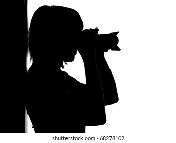 Silhouette of woman with photo camera isolated on white