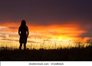 Silhouette of woman posing at sunset