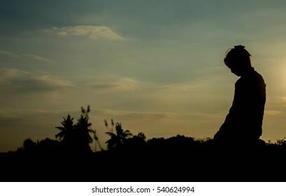 silhouette woman pray to god