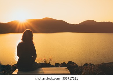 The silhouette of woman sitting alone, concept of lonely, sad, alone, person space, alone and scared