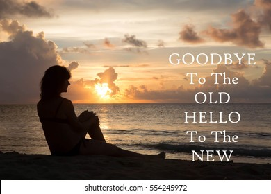 Silhouette of a woman sitting on a beach with the inspirational message of Goodbye To The Old, Hello To The New against a sunset background