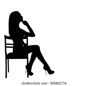 Silhouette of a woman sitting on a chair