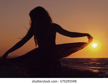Silhouette of a woman in sundress