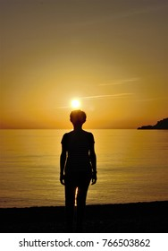 silhouette of woman in the sunset in the meditarraneo, peace, calm, serenity, harmony, fullness, well-being, nature, natural, contemplate, meditate, breathe, grow, happiness, tranquility, fulfillment,