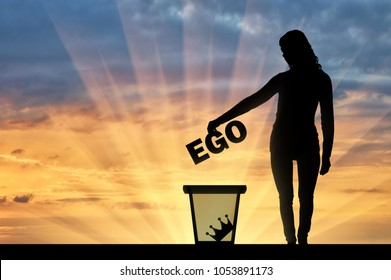Silhouette of a woman throws the word ego into the garbage bin. The concept of selfishness as a bad habit from which it is necessary to refuse