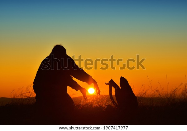 silhouette-woman-trying-catch-sun-600w-1