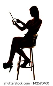 Silhouette of a woman using a tablet pointing.