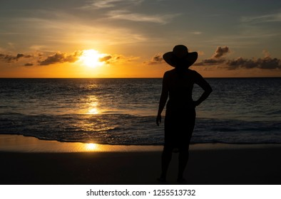 Silhouette of a Woman Watching the Sunset on a Caribbean Beach