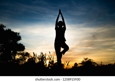 silhouette woman with yoga poses
