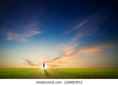 silhouette woman with yoga post against sky