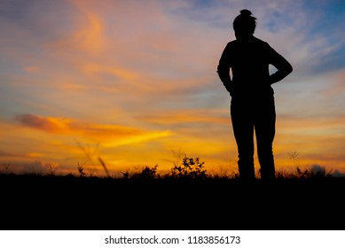 Silhouette women looking success at not far away.