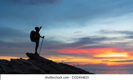 silhouette  women on top of mountain peak , success, winner, leader concept .