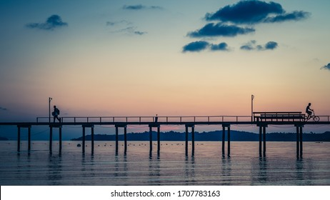 Silhouette Wooden Bridge With Sea View At Dawn