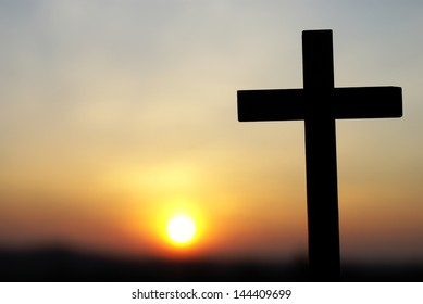 Silhouette of wooden cross on sky background with copy space.