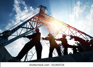 silhouette workers on background of construction