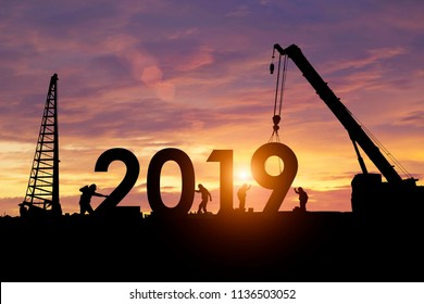 Silhouette workers work constructively to create. 2019 New Year
