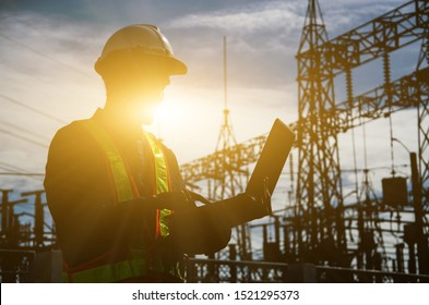 Silhouette of working engineer in the construction site.