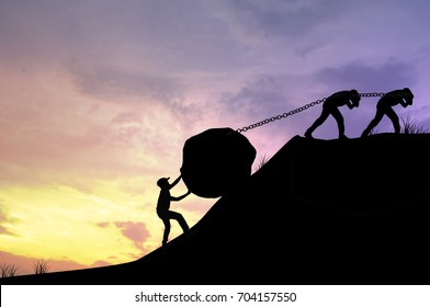 silhouette working team of men helping to pull and push big rock to be target, concept as  improving and development business