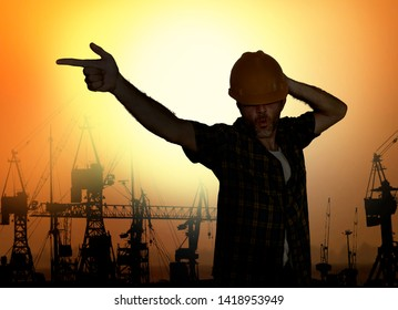 silhouette of workman dancing happy emulating with construction helmet pop star pose celebrating workday is over isolated on harbour cranes background as cheerful worker on Friday