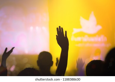 Silhouette worship hand on blurred church background
