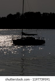 silhouette of the yacht on the lake